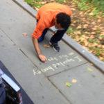 N writing on sidewalk